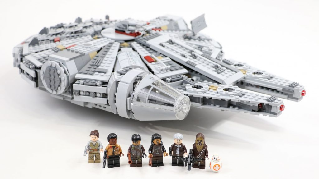 A close-up image of the Millennium Falcon with 7 mini-figures, including Han Solo, Chewbacca, Leia, and BB8. The set is part of the Force Awakens merchandise
