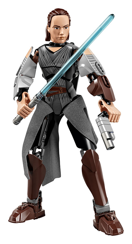 LEGO action figure of Rey holding a blue lightsaber and a blaster