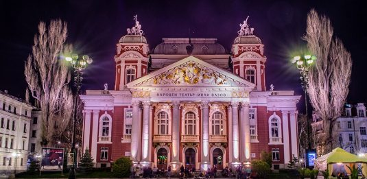 A photograph of the National Theater Ivan Vazov in Sofia taken at night
