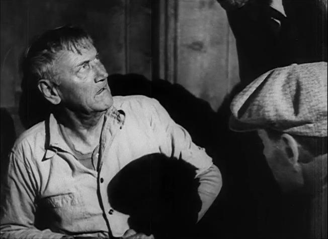 Снимка от филмовата адаптация (1940) по Гроздовете на гнева - Чарли Грейвин в ролята на Уилям Джеймс Джоуд